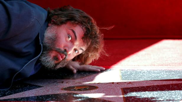 Actor Jack Black kisses his star at its unveiling on the Hollywood Walk of Fame in Los Angeles