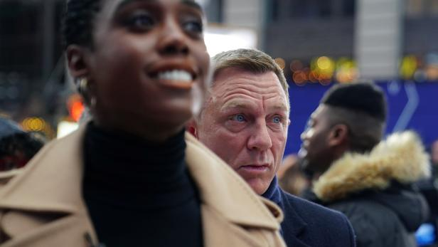 """Actors Lashana Lynch and Daniel Craig attend a promotional event on TV in Times Square for the new James Bond movie """"No Time to Die"""" in the Manhattan borough of New York City"""