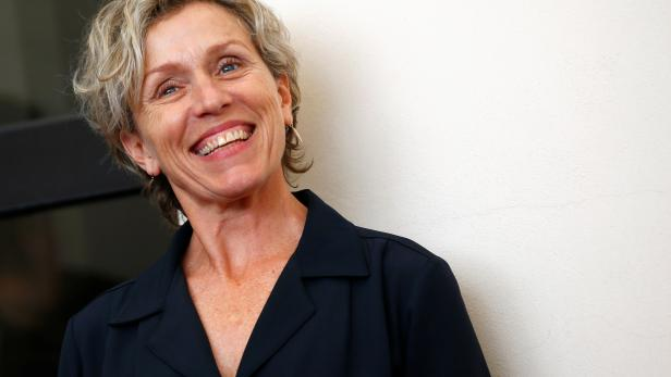 """FILE PHOTO: Cast member Frances McDormand poses during a photocall for the TV mini-series """"Olive Kitteridge"""" at the 71st Venice Film Festival"""