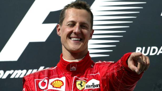 FILE PHOTO: Michael Schumacher - Ferrari celebrates winnning the race